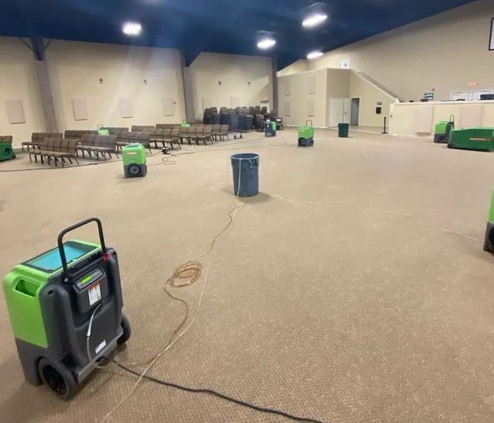 SERVPRO drying equipment on church stage floor