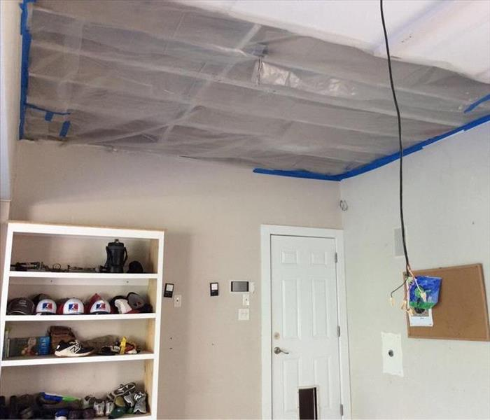 Ceiling with plastic barrier held by tape
