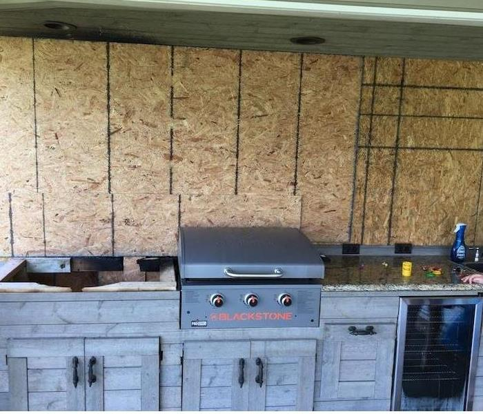 Cabinet and grill with fiberboard wall