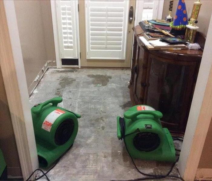 SERVPRO equipment in the room with an exposed subfloor