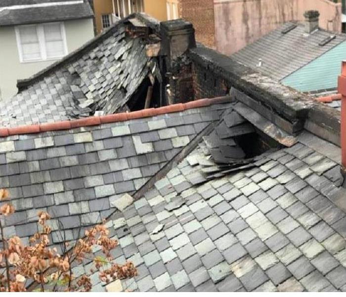 A roof of a home damaged by a fire