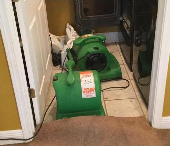 Two of our air movers drying the carpet in this home