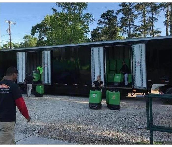 Black trailer that has SERVPRO equipment in it.