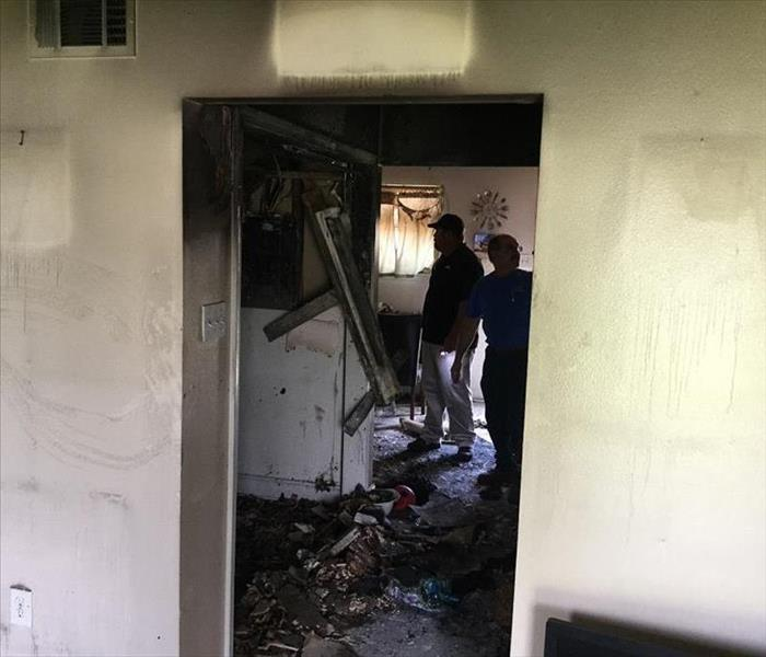Surveying inside of fire damaged home