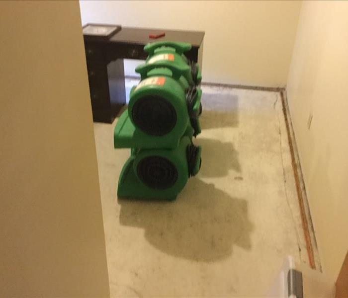 Air movers stacked on a concrete floor